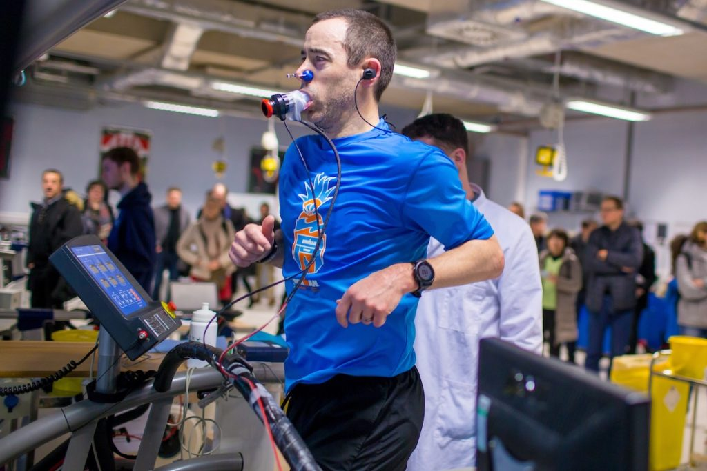 A man on a treadmill having his breathing monitored by sports scientists from Liverpool John Moores University.